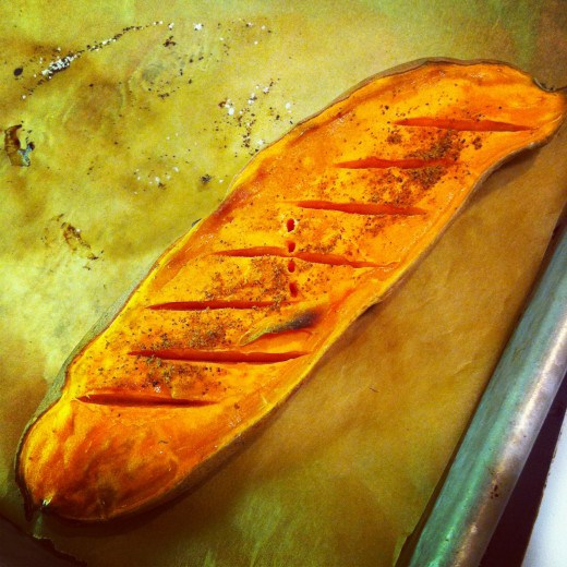 A roasted sweet potato. You can tell its a sweet potato because of the orange interior flesh--1 of 2 types of sweet potatoes sold in US Markets. Source: Micki Seibel, March 2012
